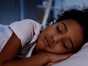 Kid sleeping in bed